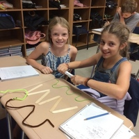 4th grade Science students at LCE making inquiries about how energy moves waves..