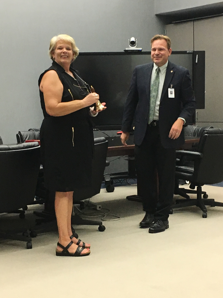 Superintendent presenting award to retiring Adult Education Director