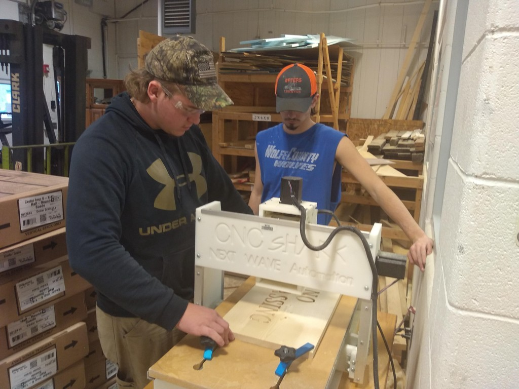 Students using CNC to make signs