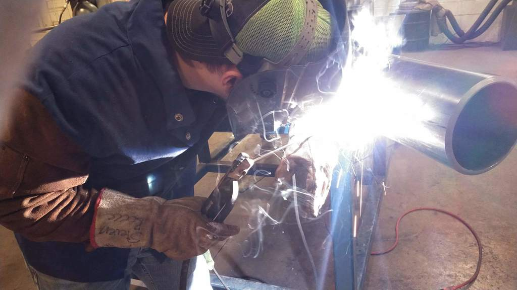 Student welding on Pipe