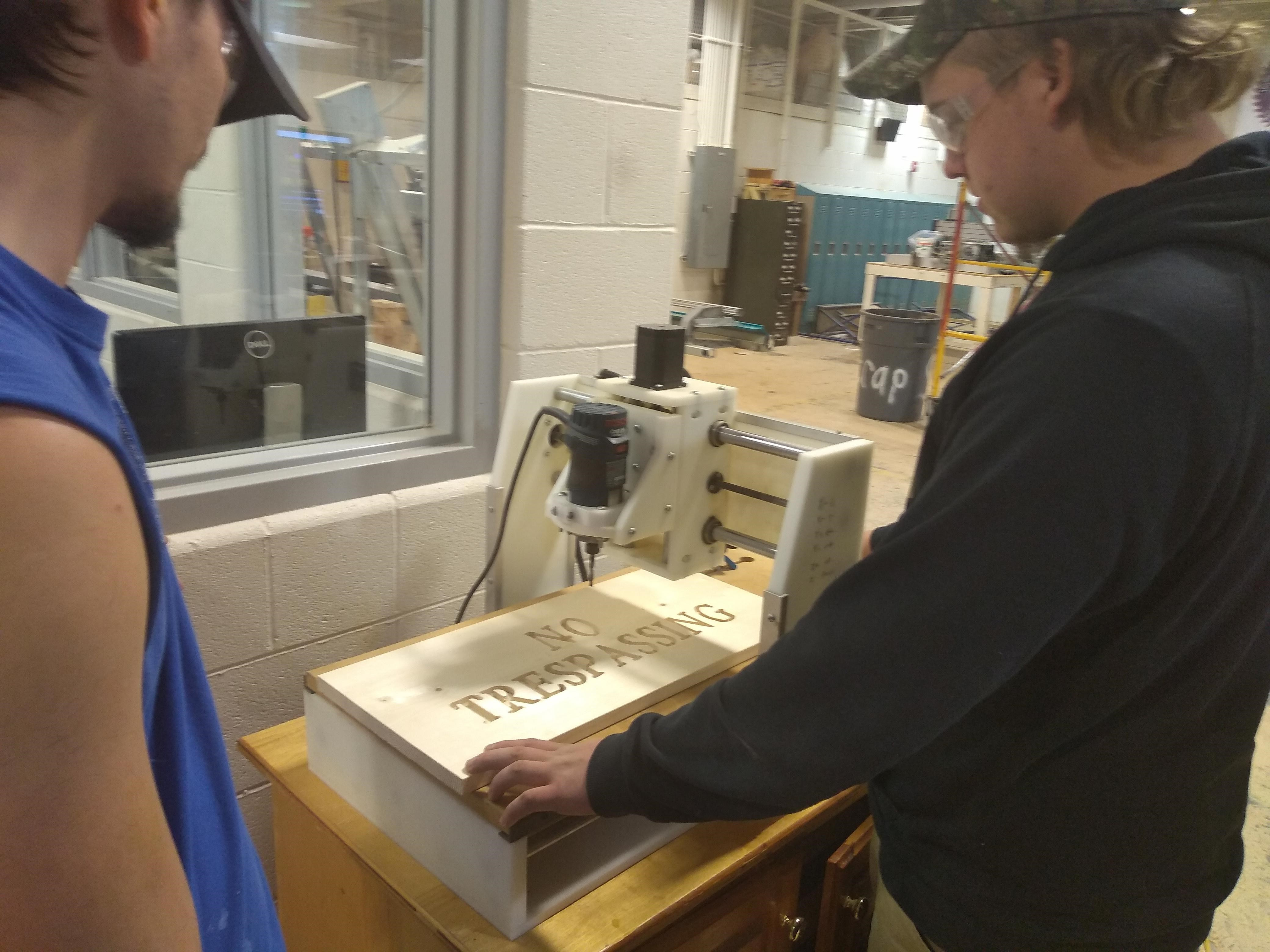 Students using CNC router