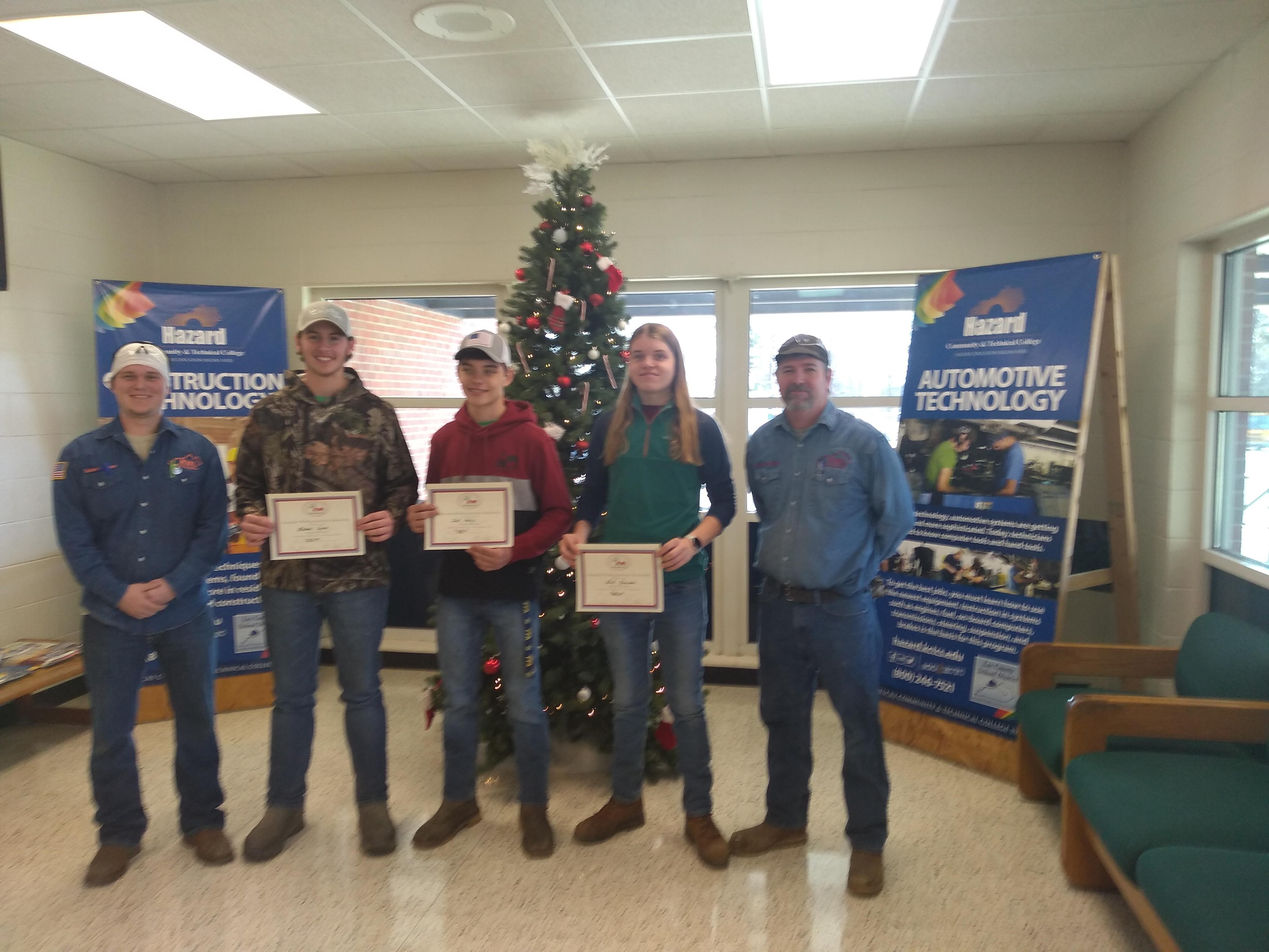 Student winning KWI welding scholarships